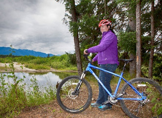 Woman cycling in Kitimat